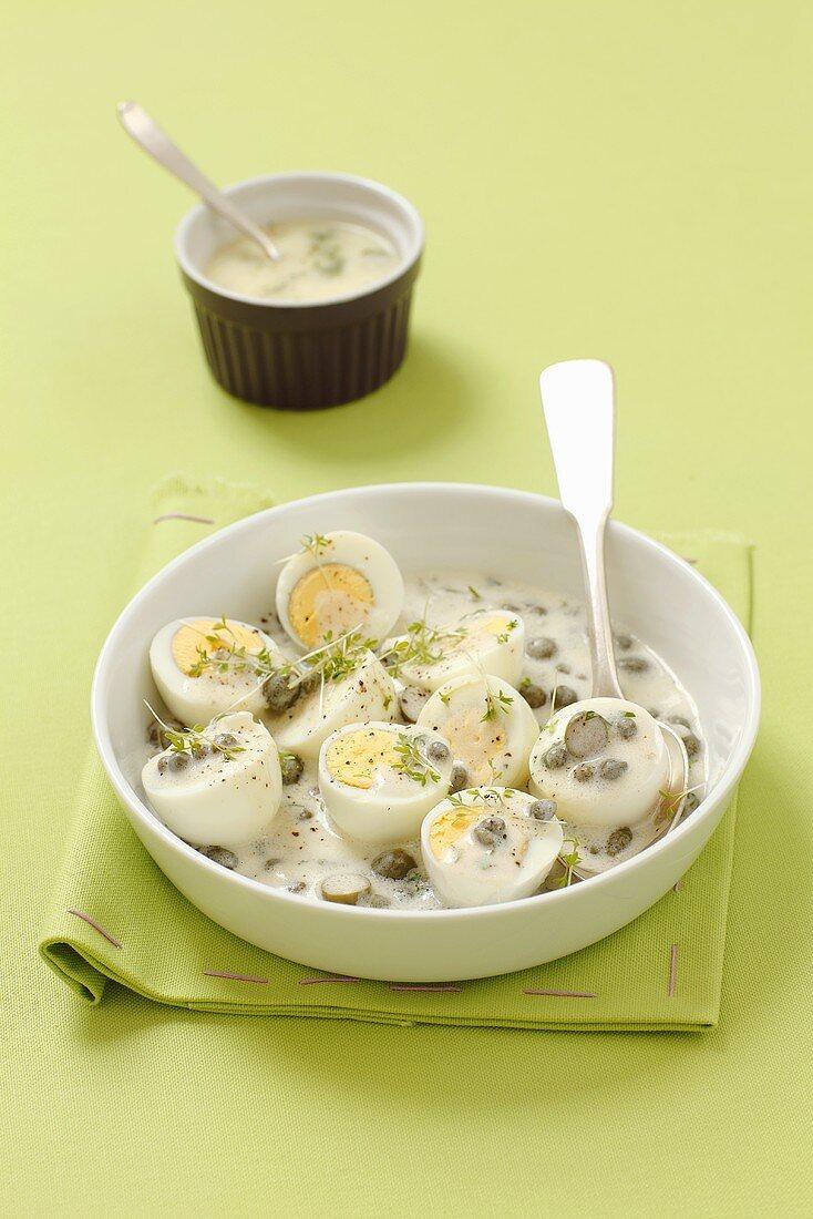 Hard boiled eggs in a caper sauce