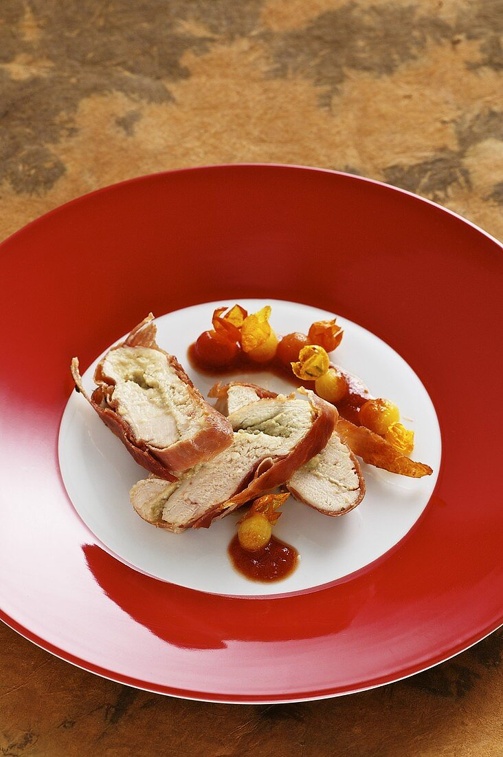 Stuffed guinea fowl breast wrapped in ham and sage