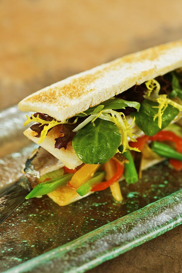 Sardine sandwich with lettuce and vegetables