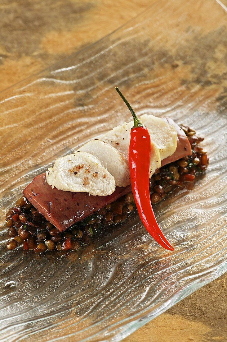 Saddle of rabbit with veal liver and pickled lentils