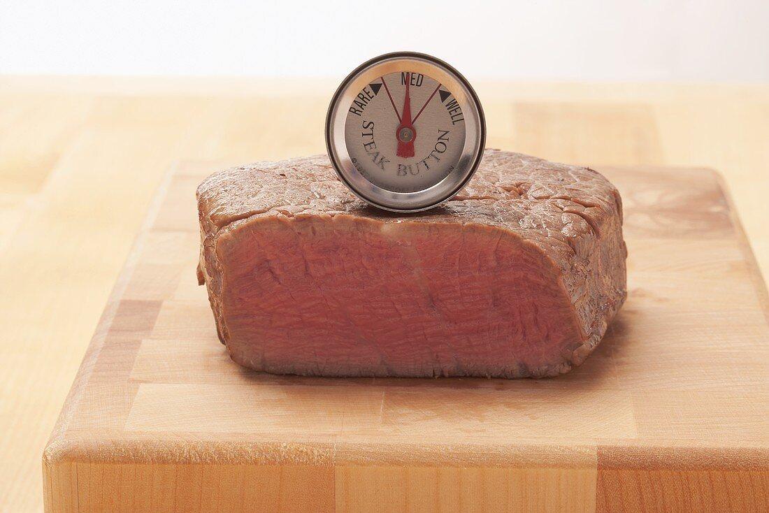 The core temperature of a beef steak being taken (medium)