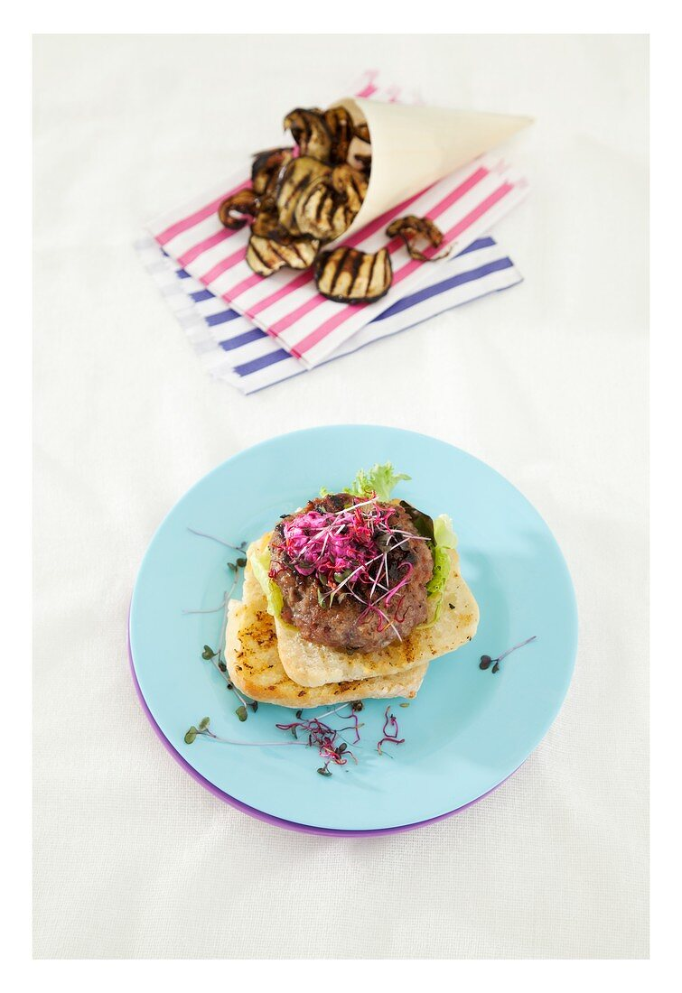 Lamb burger with mint, beetroot tzatziki and aubergine chips