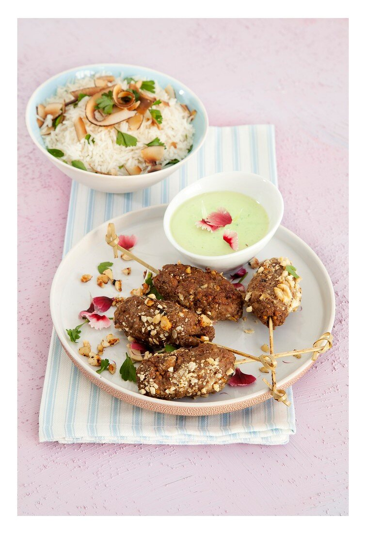 Meat kebabs with green curry sauce and coconut basmati rice