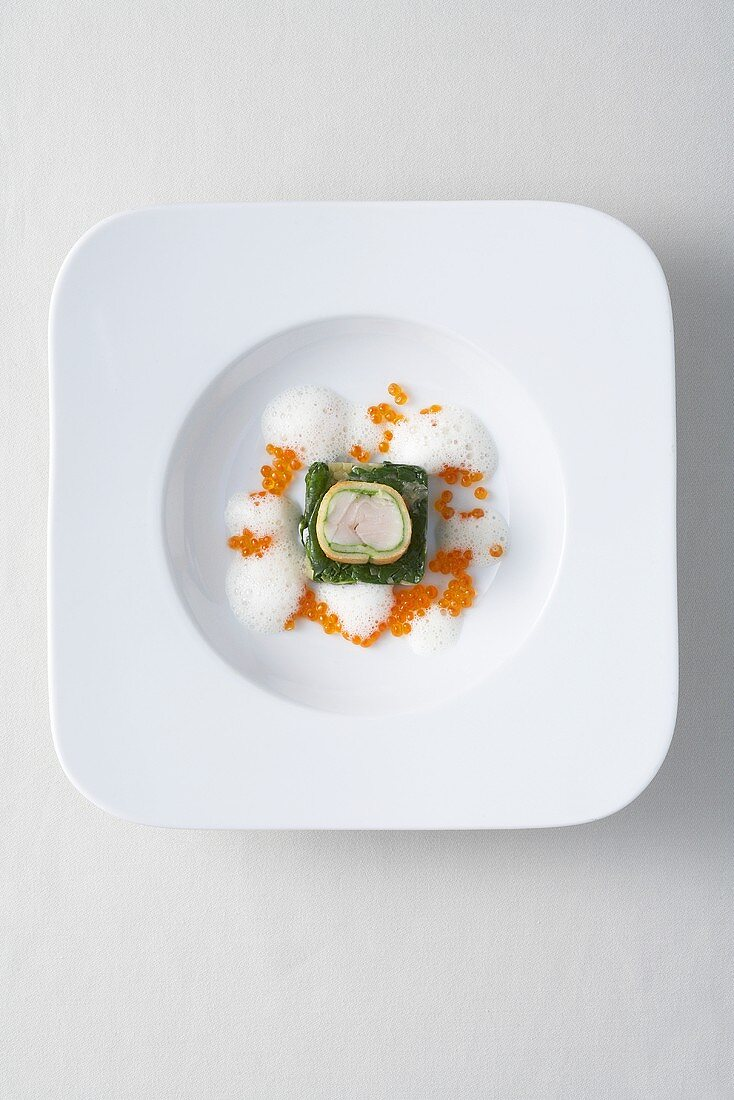 Char fillet wrapped in bread with spinach and caviar sauce