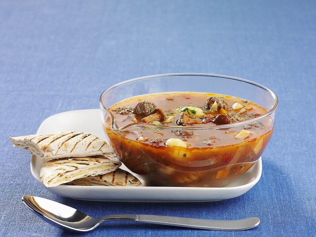 Elk soup with chanterelle mushrooms