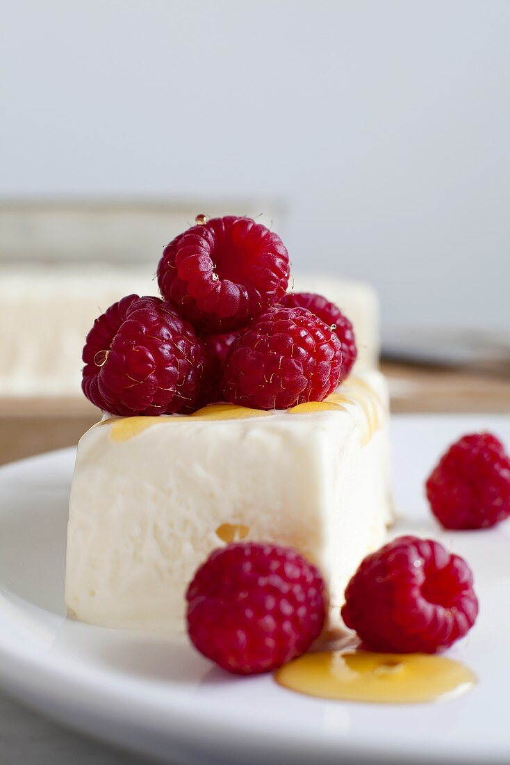 Lemon parfait with raspberries and honey