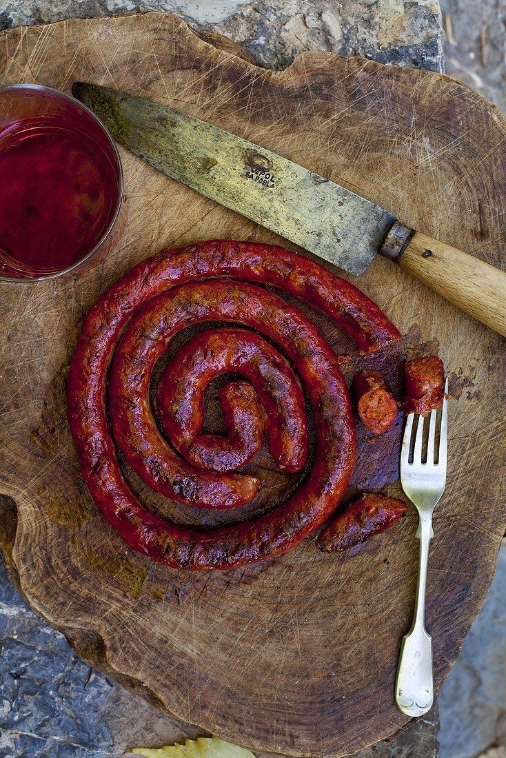 Grilled botifarra (or butifarra), Catalan sausage
