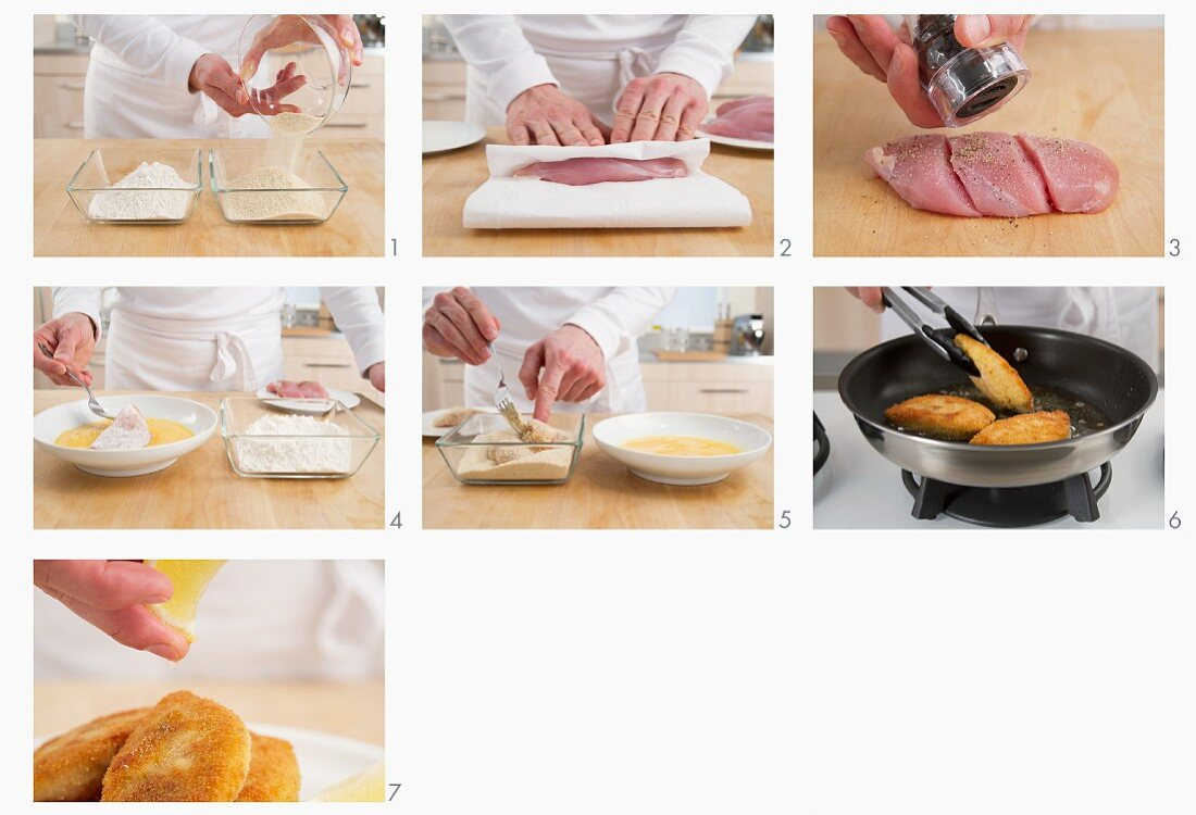Breaded chicken breasts being prepared