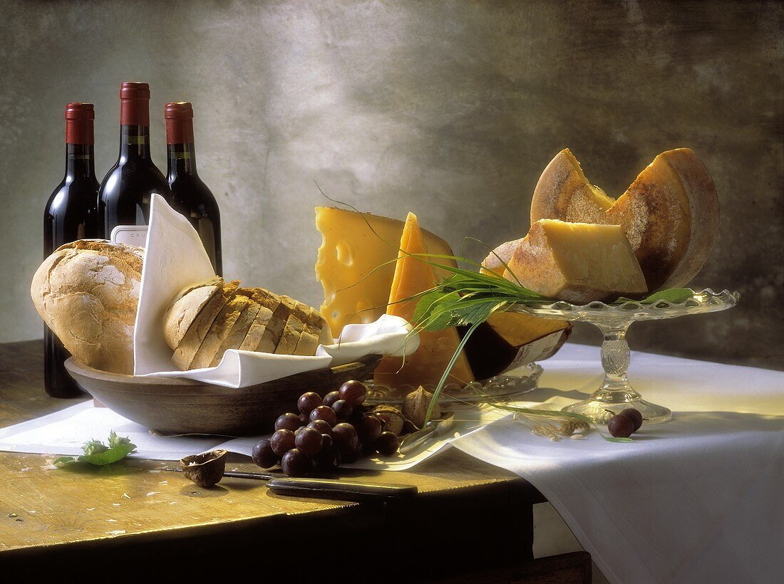 Assorted Types of Cheese with Bread; Red Wine