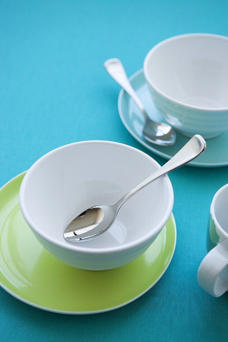 Breakfast crockery (a coffee cup and a muesli bowl)
