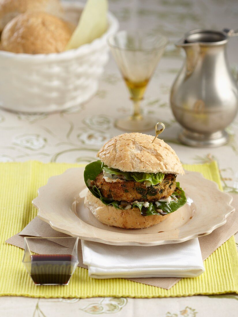 Chickpea and spinach burger with dolce latte and pomegranate syrup