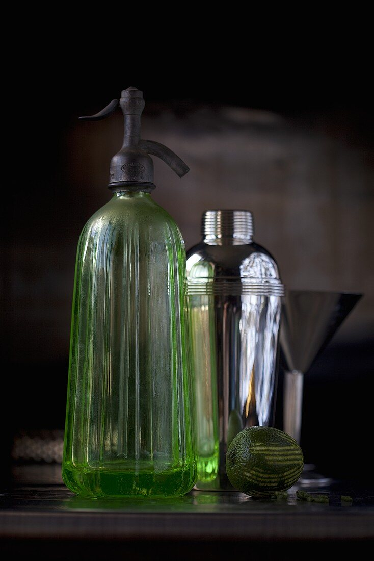 A shaker and a soda bottle