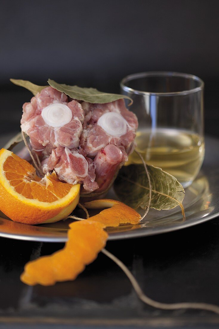 Veal tail with bay leaves, wine and orange
