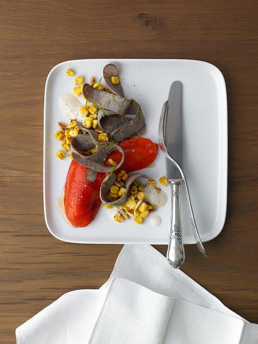 Bison Bratwurst-Tagliata on pine nut - corn kernel salad and roasted peppers