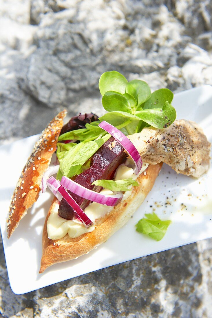 Sandwich with mayonnaise, smoked mackerel and red beets