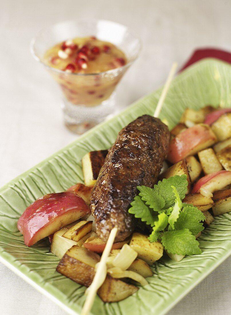 Cinnamon meatballs with roast potatoes and apples