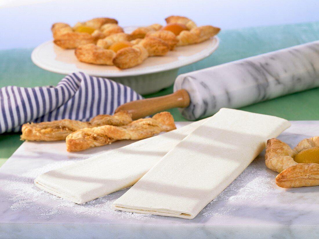 Baked good made with puff pastry ('Blätterteigstangen' puff pastry rods, 'Windräder' wind wheels)