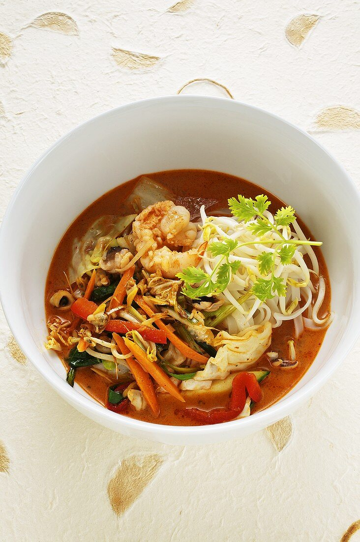 Soup with Ramen noodles, coconut milk and seafood