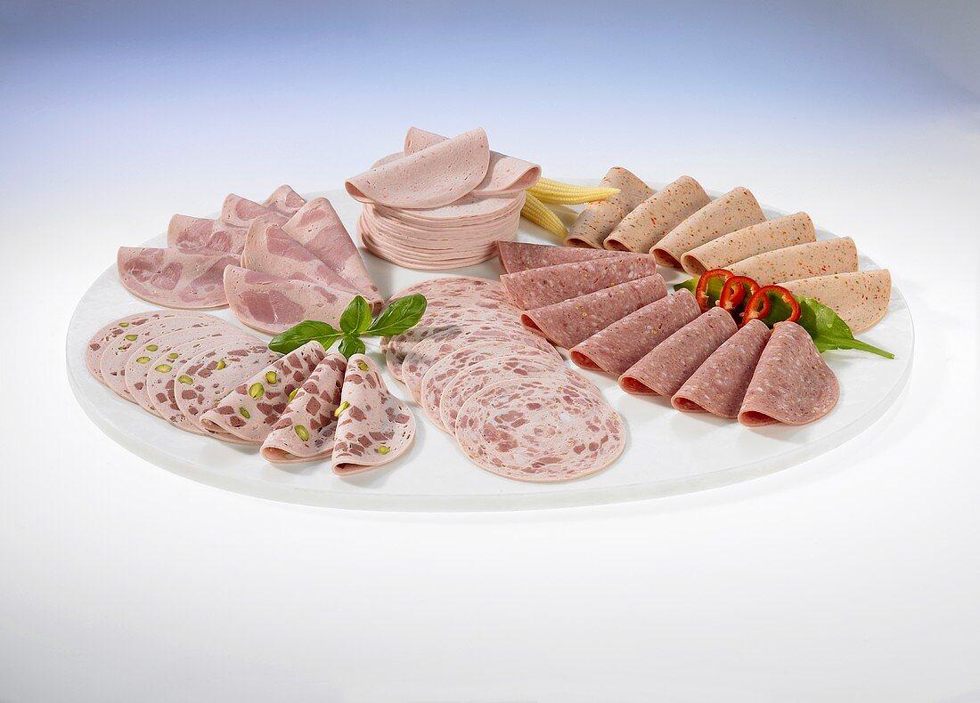 A selection of cold cuts (Lyon sausage, mortadella, ham sausage, beer sausage)