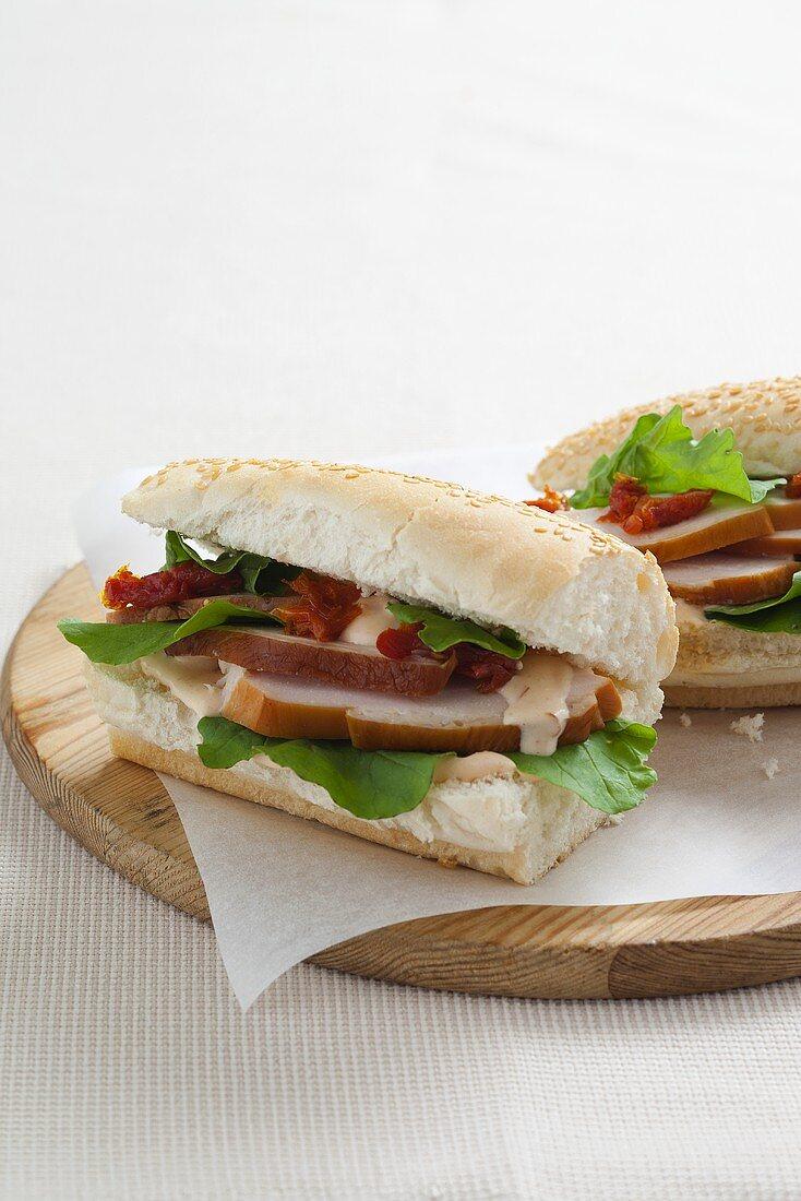 A chicken and harissa sauce sandwich on a baguette