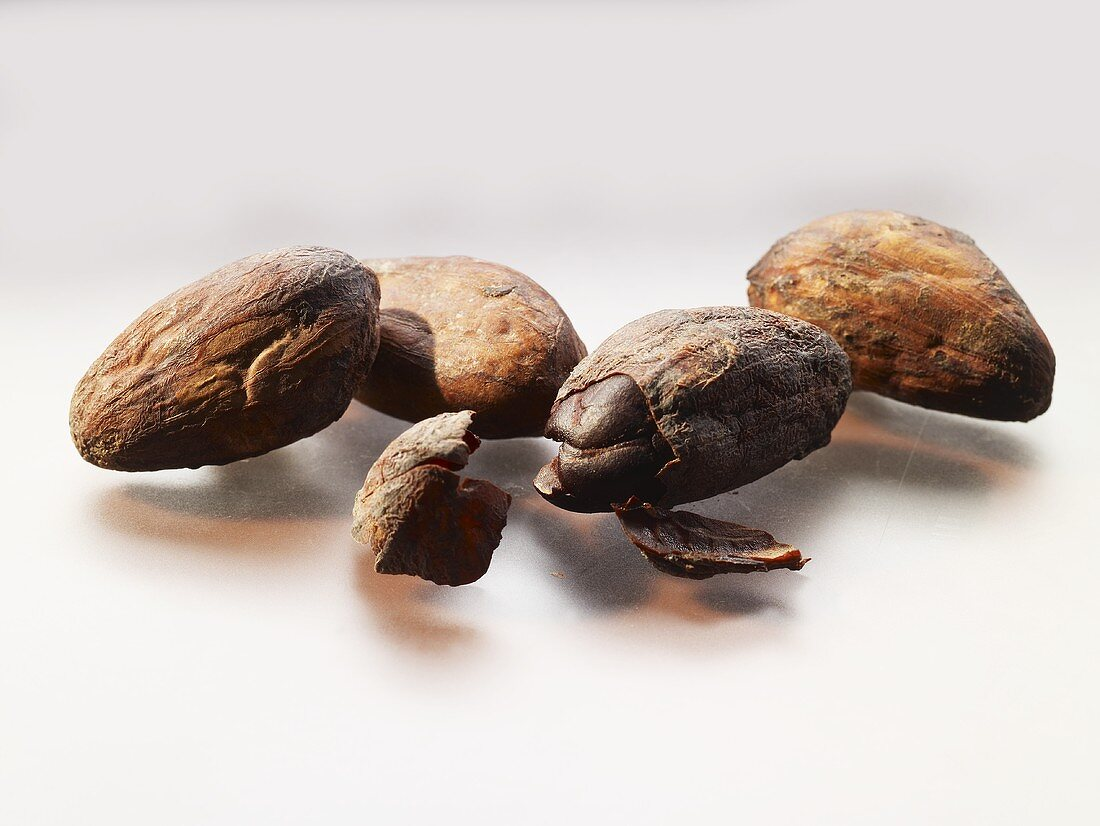 Four cocoa beans (close-up)