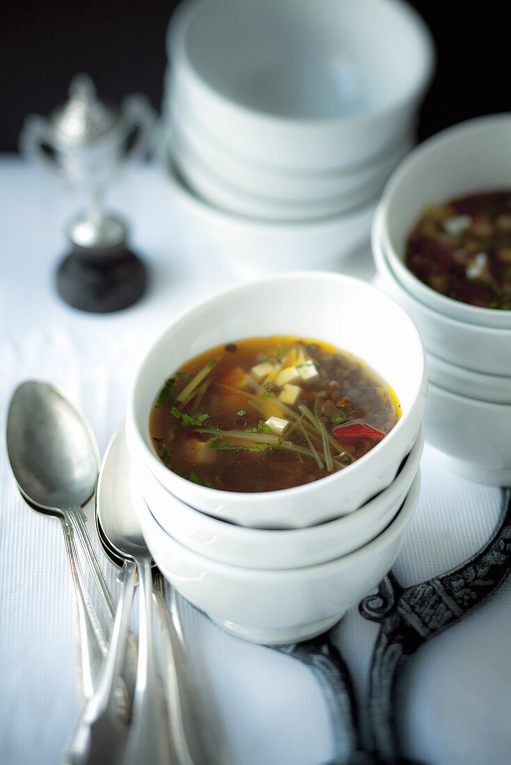 Lentil soup with feta on a buffet table at a party
