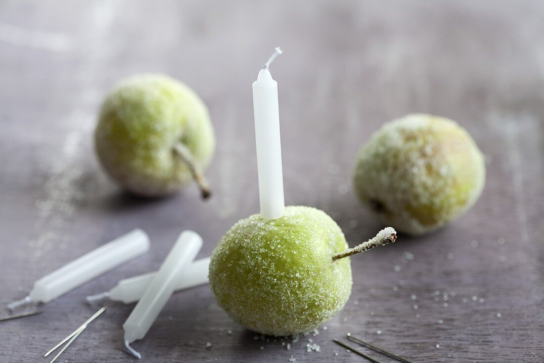 Sugared apples with candles