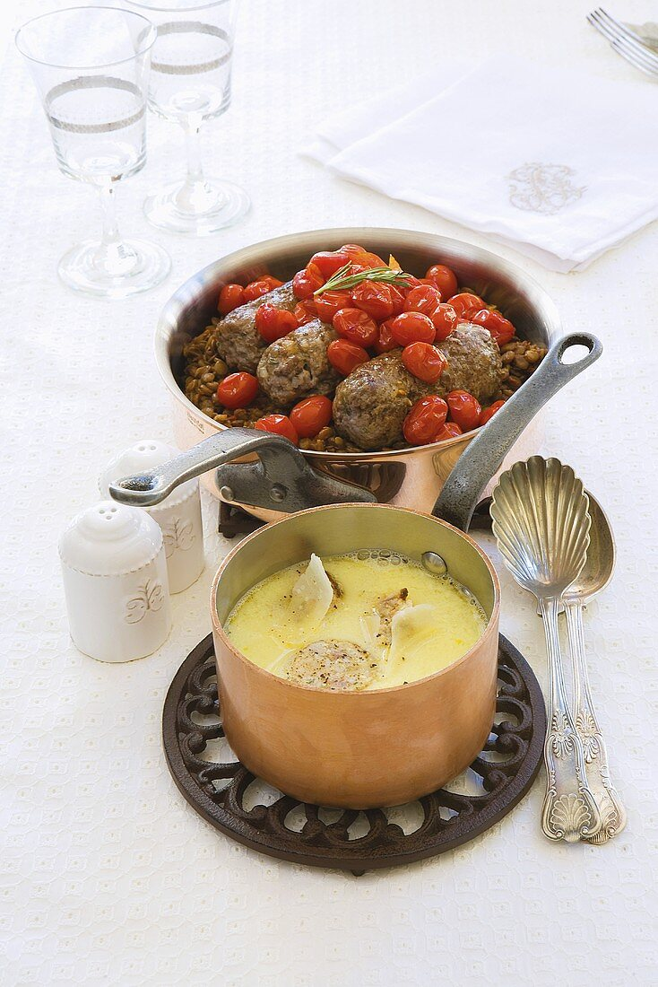 Lamb meatballs with tomatoes and lentils and egg soup with chicken sausages