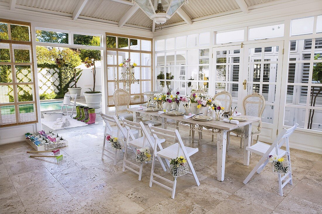 A festively laid table in a conservatory