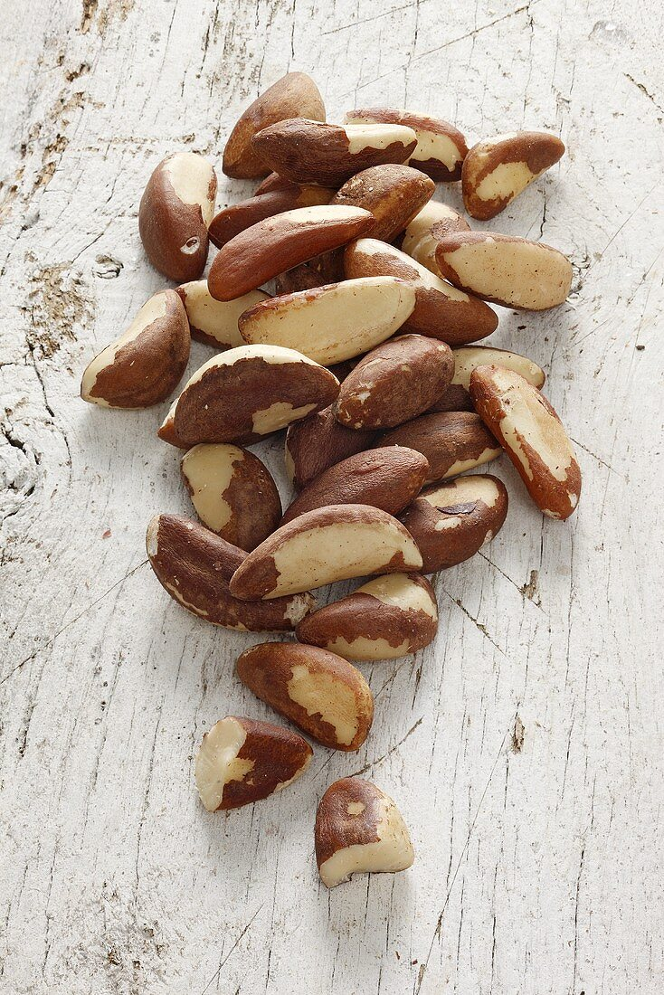 Pecan nuts on a white wooden surface
