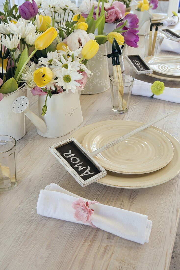 A place setting with a name card on a table set with spring flowers