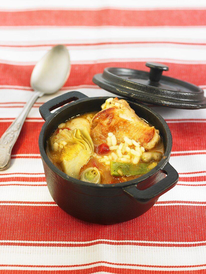 Arroz caldoso (Spanish rice stew) with rabbit and vegetables
