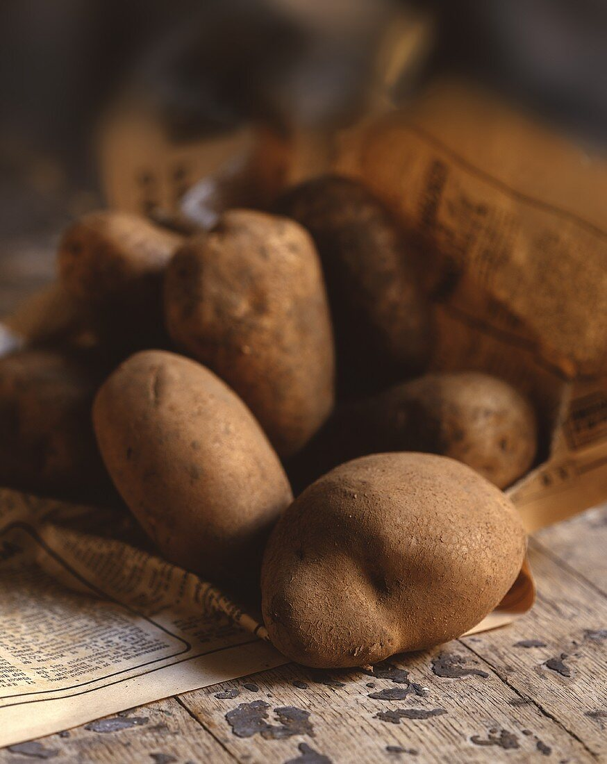 Potatoes on newspaper