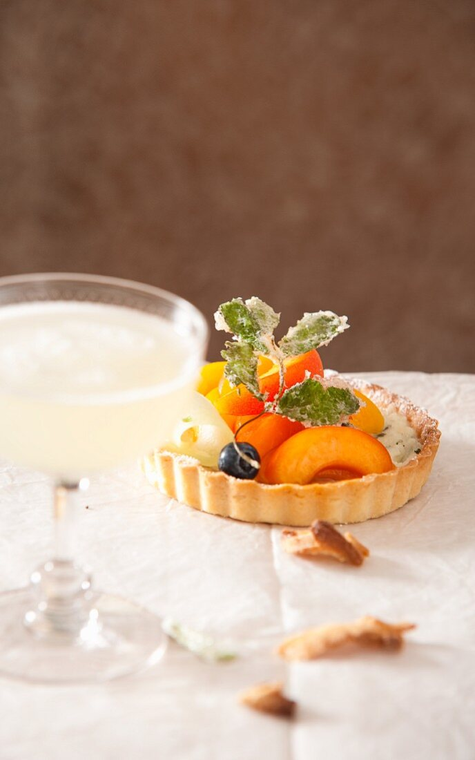 Fruit tartlets and champagne