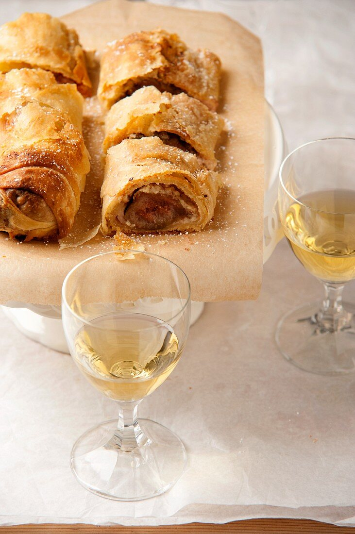 Strudel and two glasses of white wine