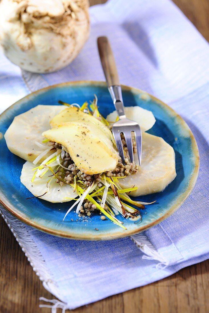 Gratinated sliced celeriac with buckwheat and scamorza