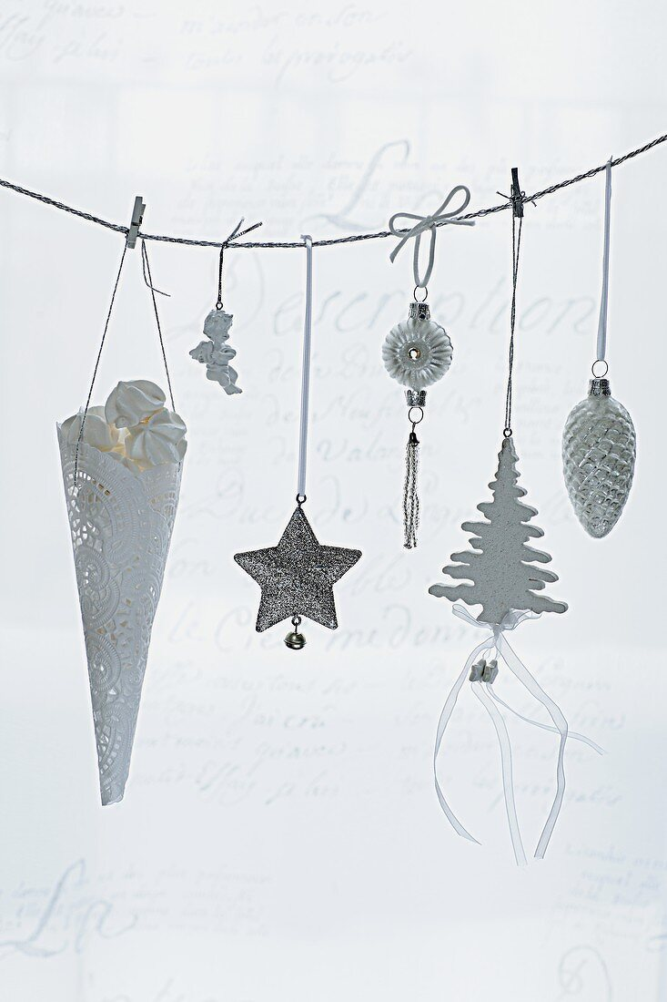 Christmas decorations hanging on a line