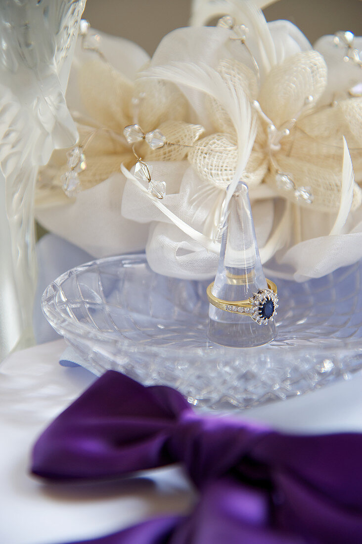 Wedding accessories: a ring holder and silk flowers