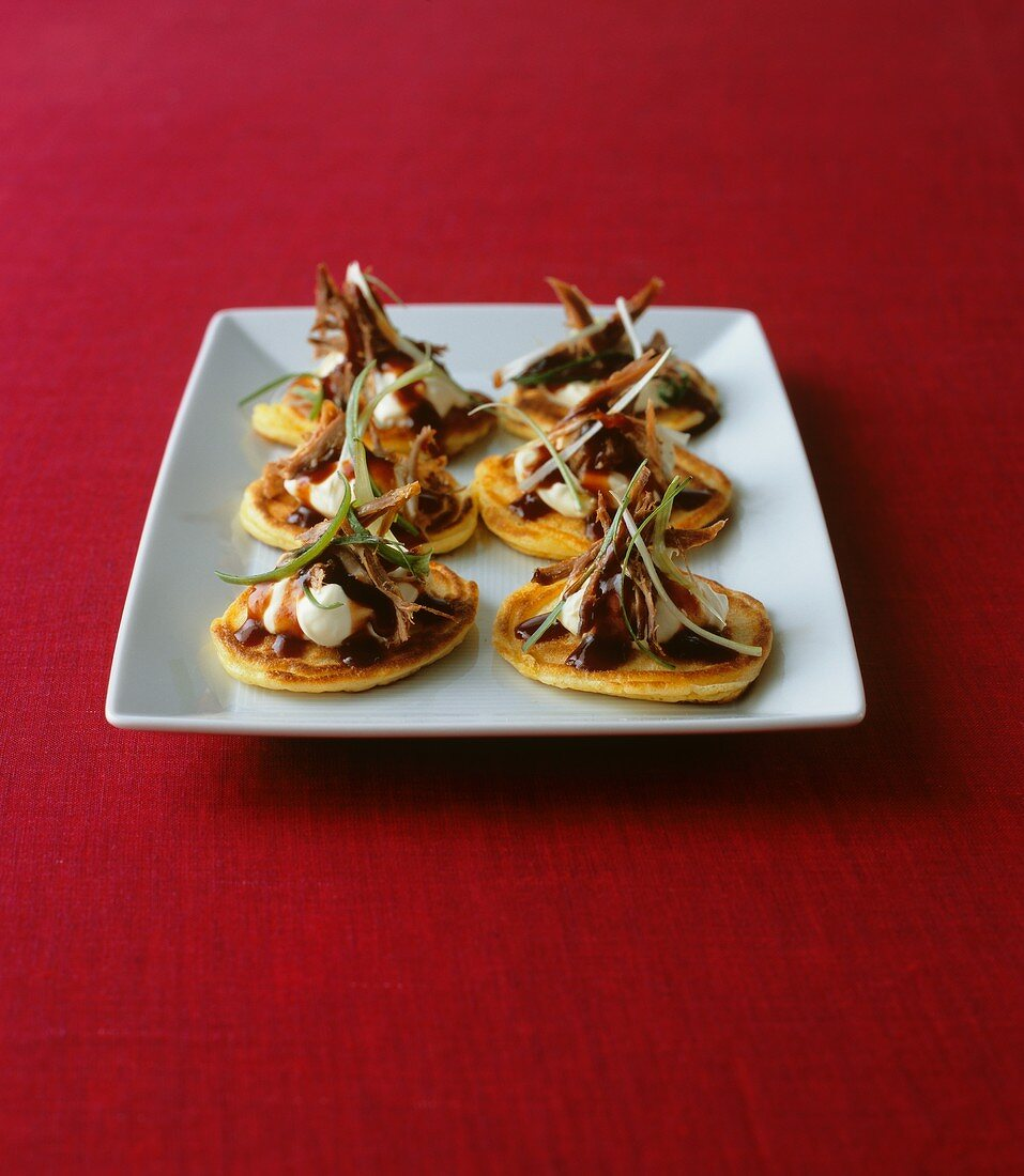 Blini with duck breast and sour cream