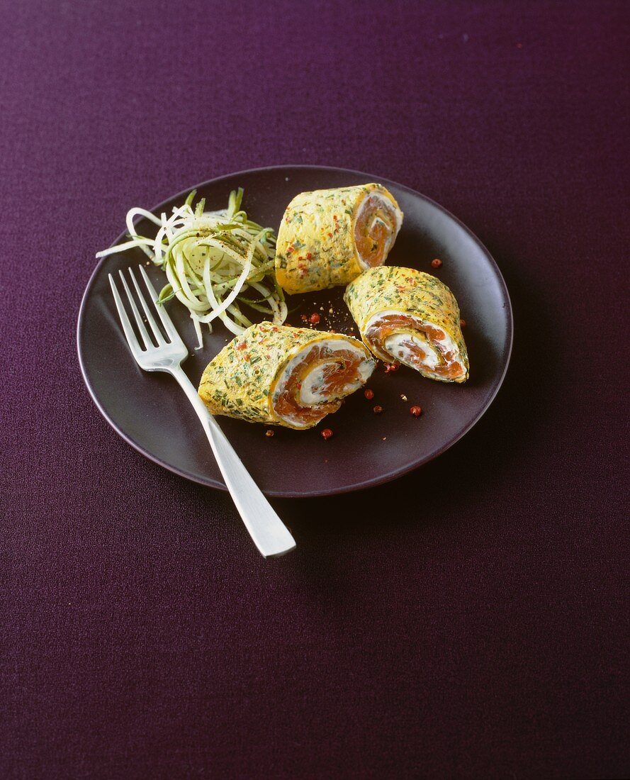 Herb pancake rolls stuffed with cream cheese and salmon