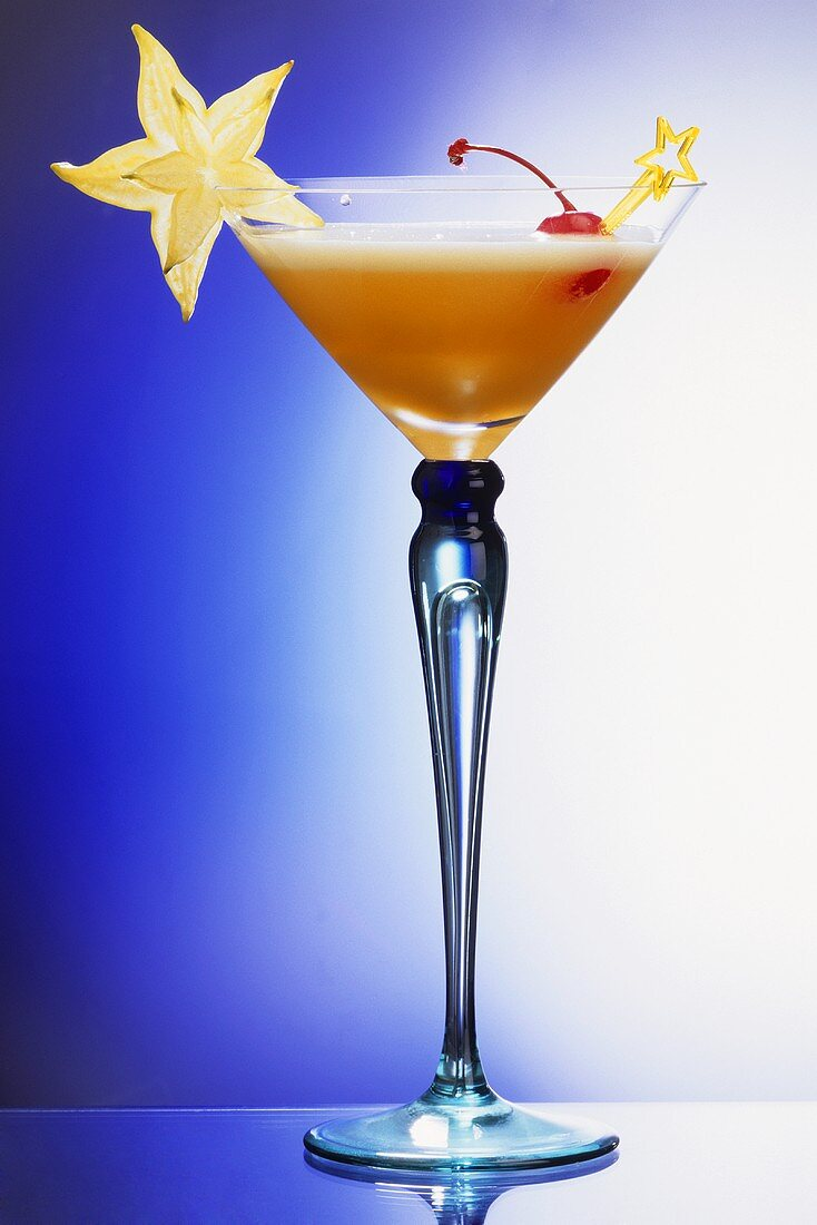 Champagne Cocktail With Star Fruit & Cherry