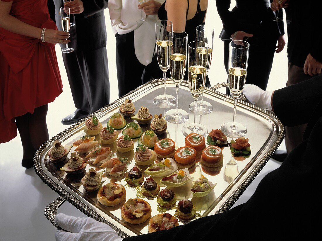Champagne and Canapes Being Served at a Cocktail Party