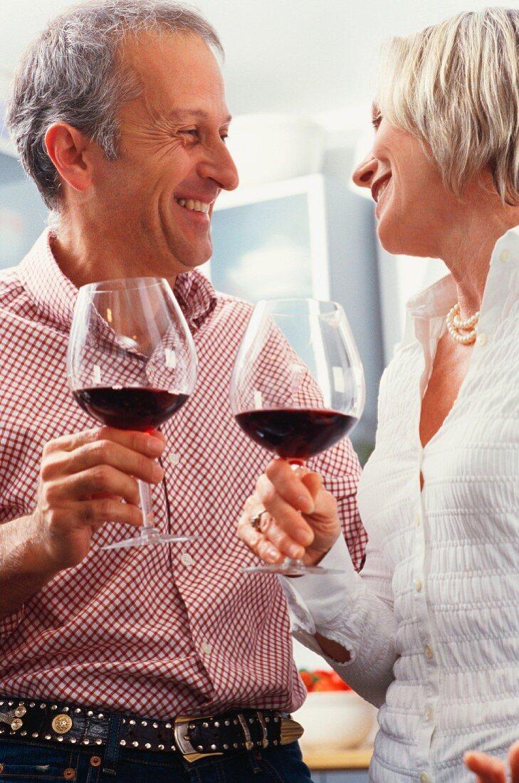 Older couple drinking wine