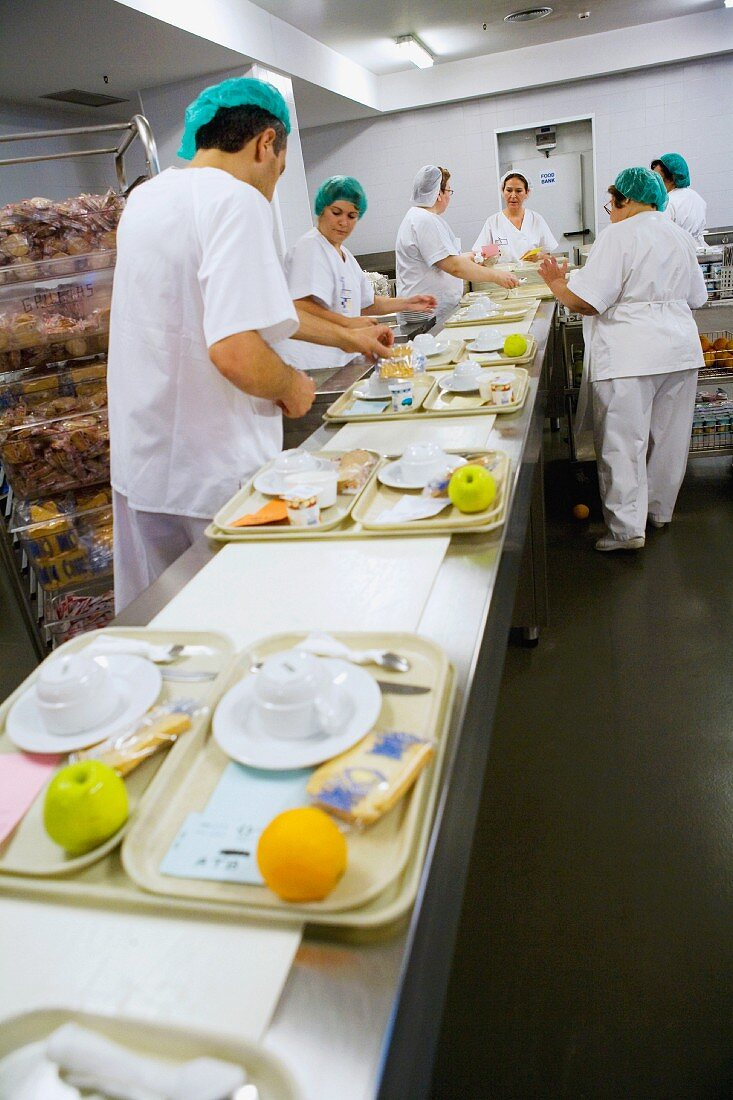 Preparing trays of food in canteen kitchen