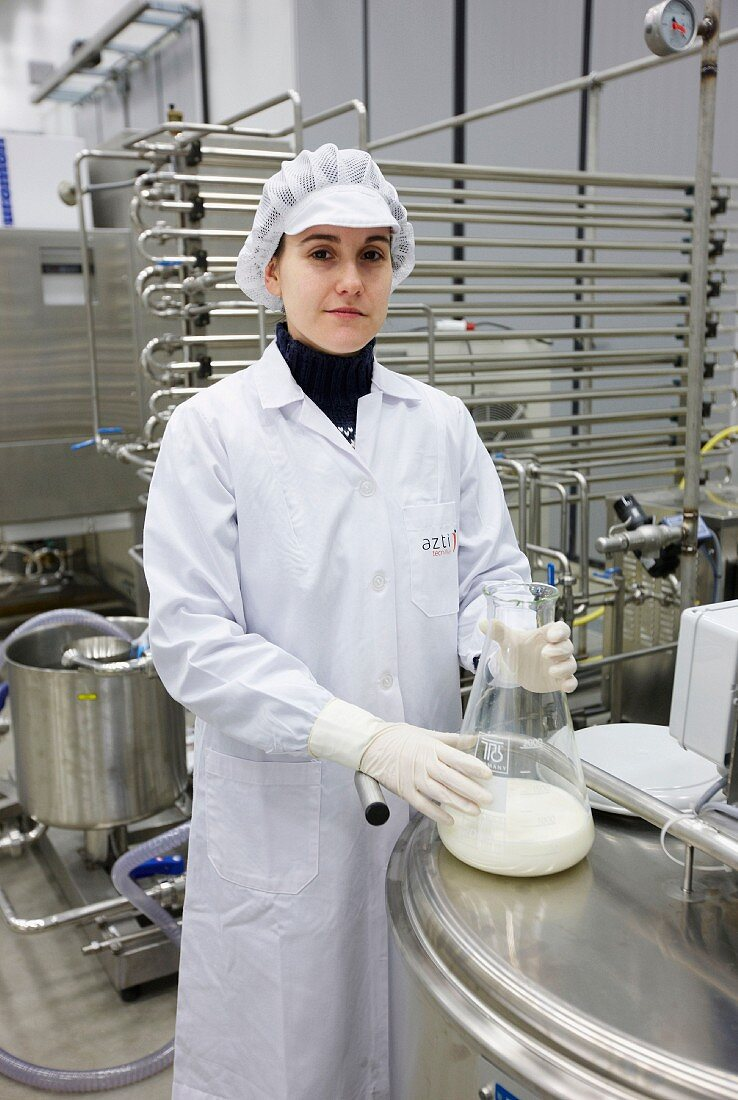 Food technician testing milk quality