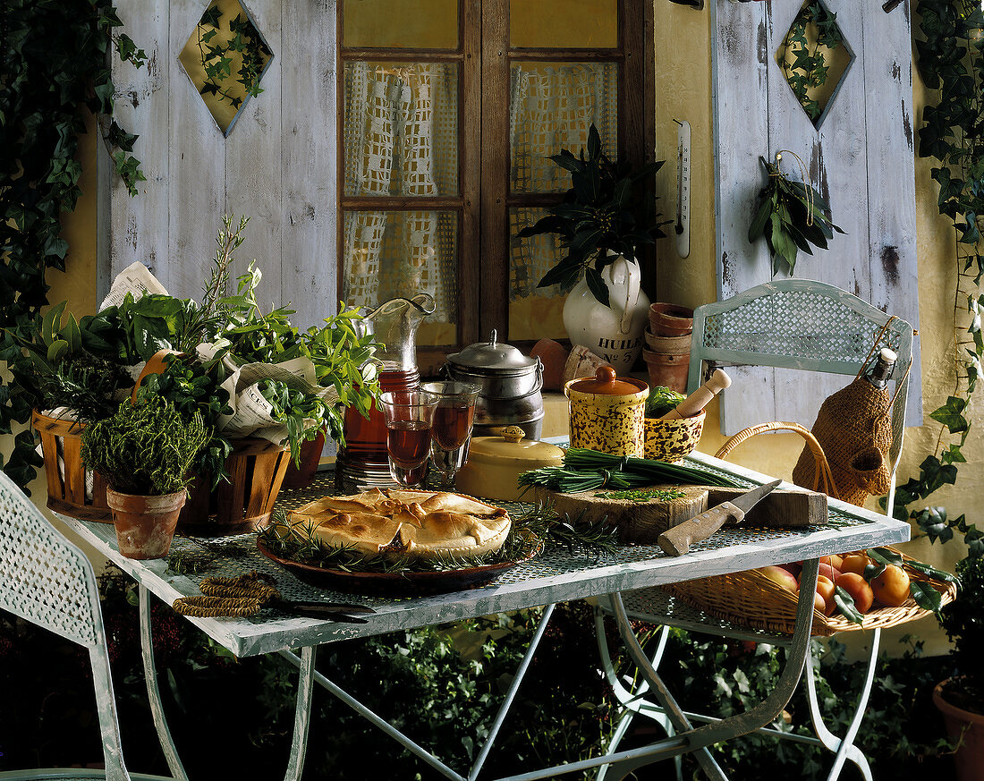 Herb pastry pie on set table outdoors