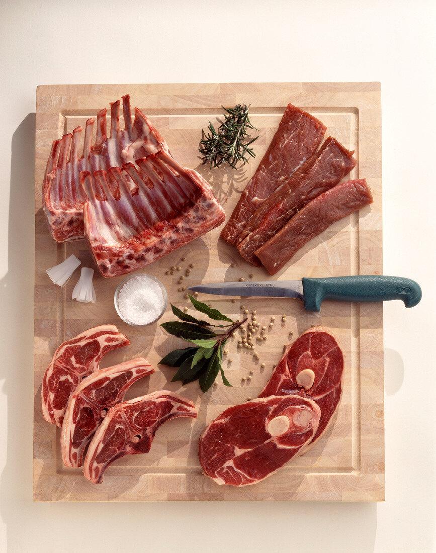 Different raw lamb cuts on a chopping board