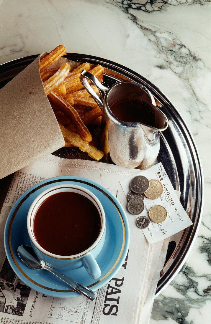 Breakfast: hot coffee and churros doughnuts