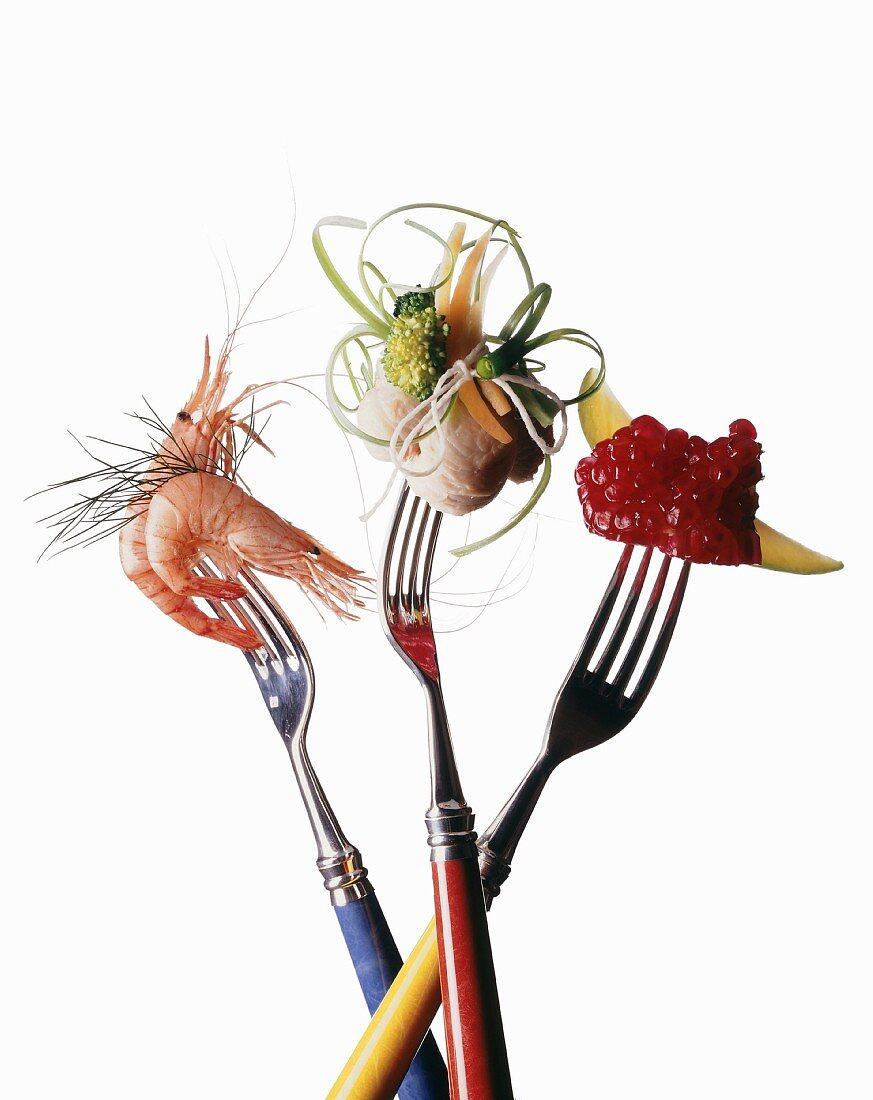Prawns and vegetables on forks