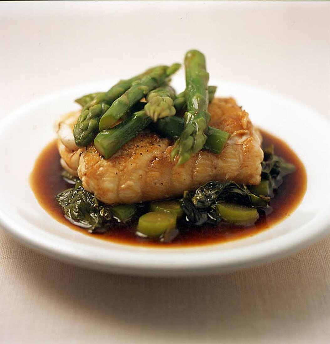 Cod back with asparagus tips and sorrel tips deglazed with soy sauce